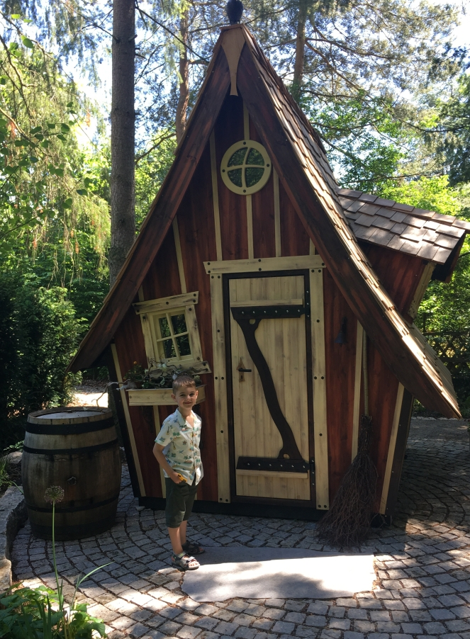 Things Helen Loves, small boy next to model of traditional German house.