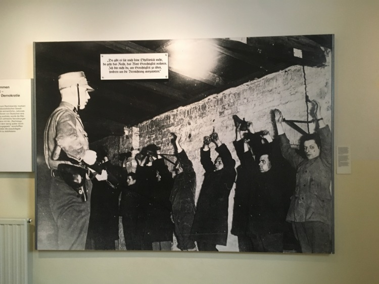 Things Helen Loves, Black and white image of soldier and prisoners