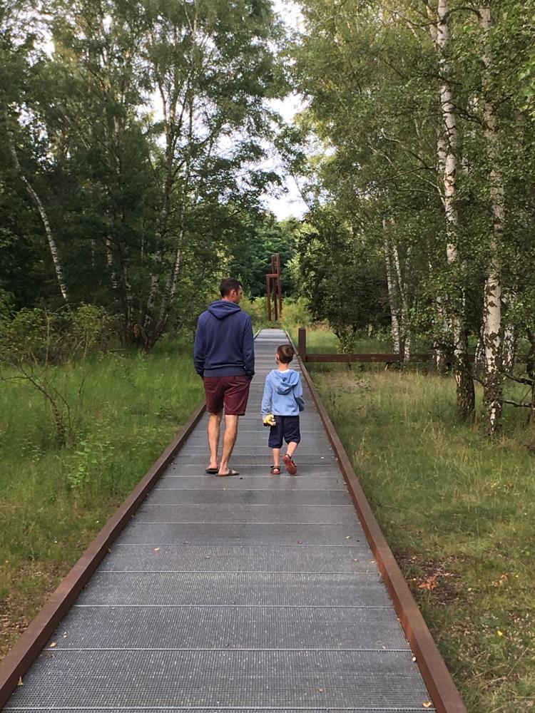 Things Helen Loves, boy and man walking on raised walkway in park setting