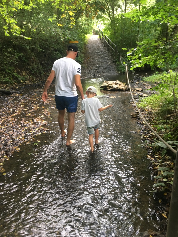 Things Helen Loves, image of man and boy walking barefoot in stream