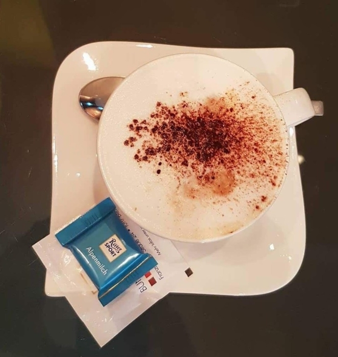 Things Helen Loves, image of a cup of coffee on a saucer with small chocolate bar