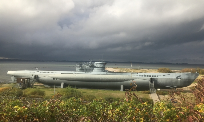 Things Helen Loves, Image of Submarine mounted on beach under grey skies.