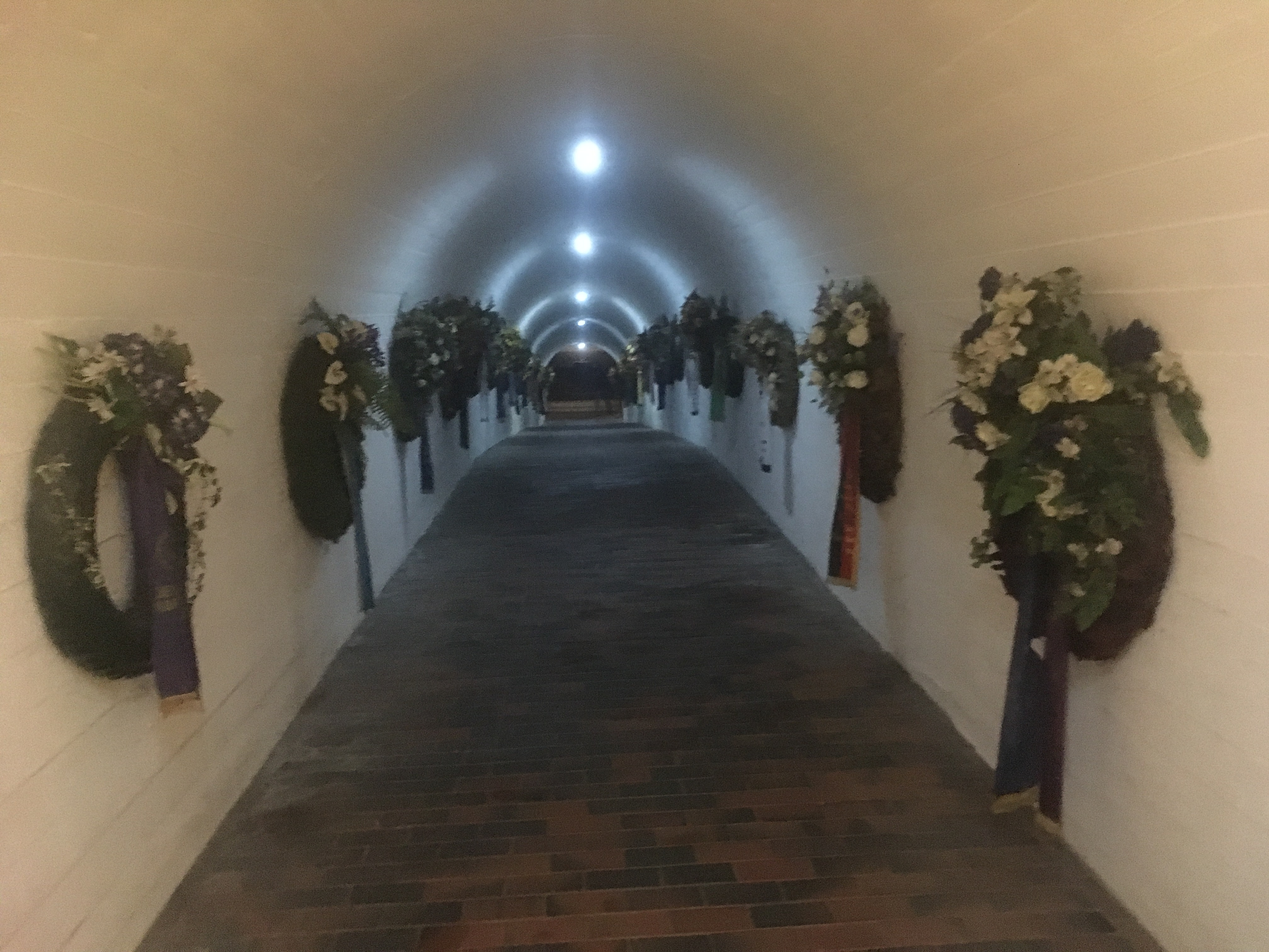 Things Helen Loves, Coridoor lined with floral wreaths leading underground