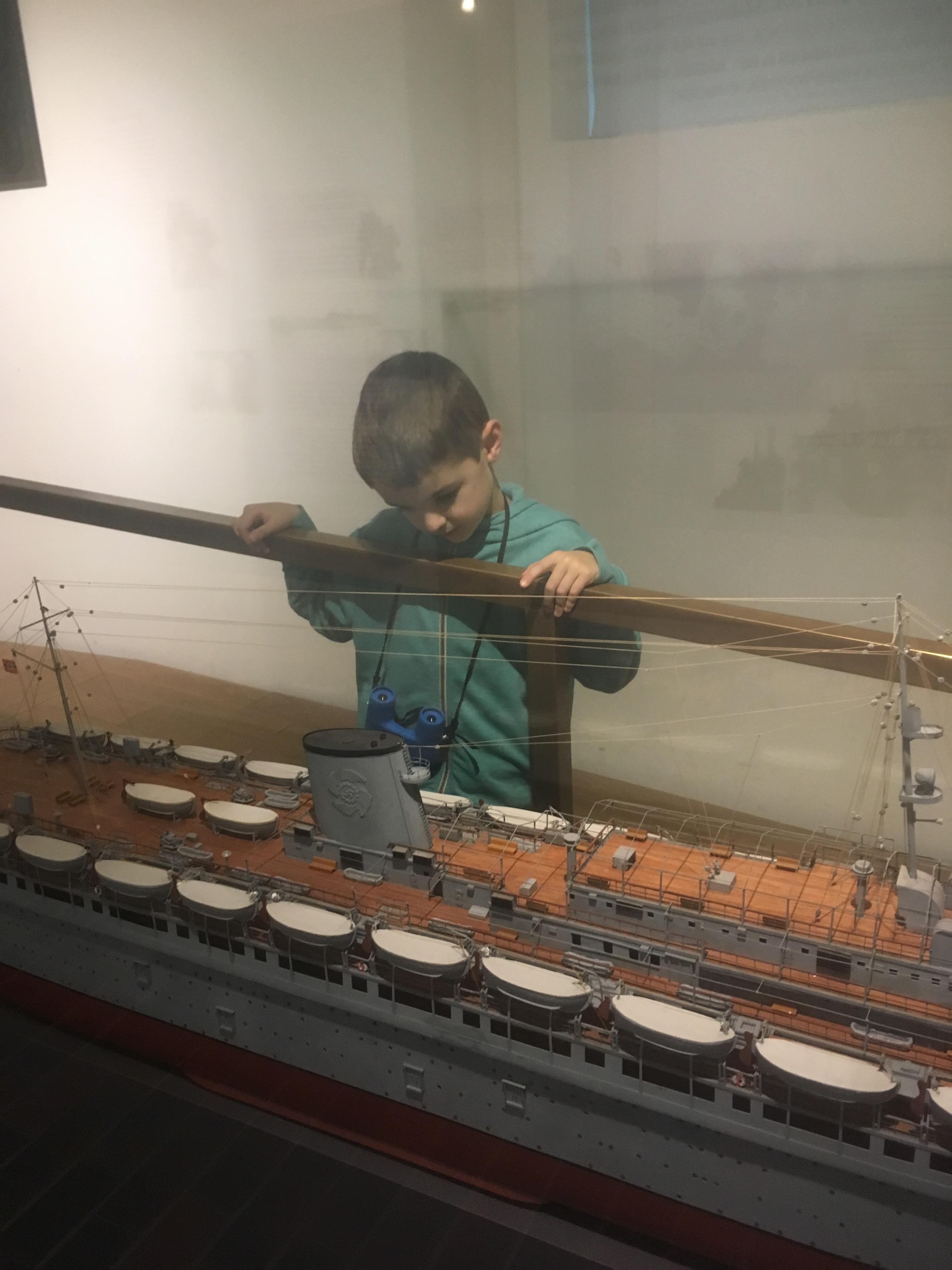 Things Helen Loves, Boy examining model ship.