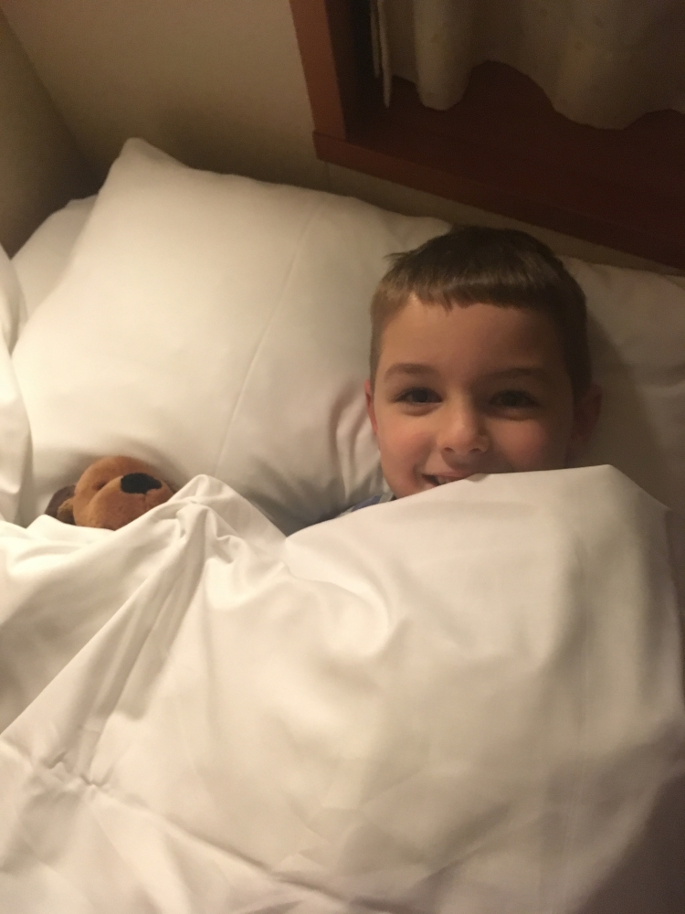 Things Helen Loves, boy and teddy in bunk onbard ship