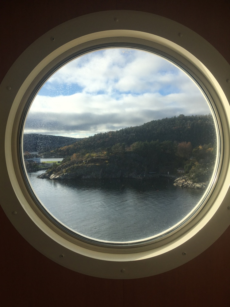 Things Helen Loves, Fjord scenery viewed through a port hole window.