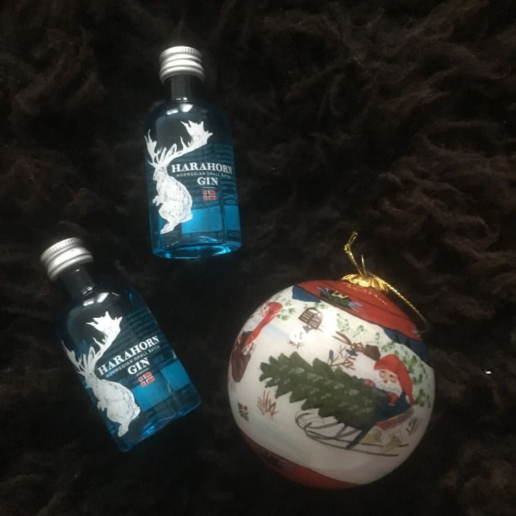 Things Helen Loves, Picture of two miniture bottles of gin and a decorated Christmas bauble.