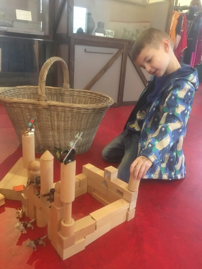 Things Helen Loves, boy building a castle with wooden blocks