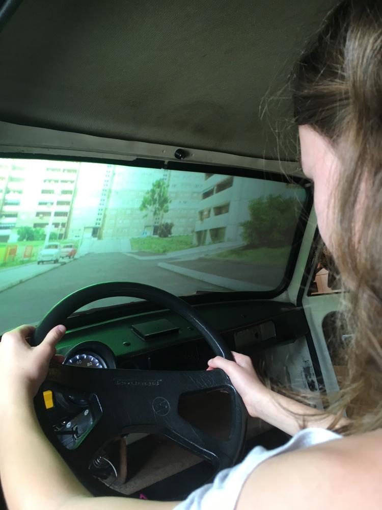 Things Helen Loves, image of girl using driving simulator