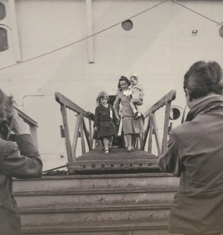 Things Helen Loves, woman disembarking boat with children