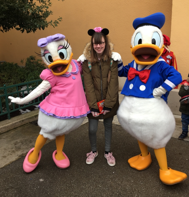 Things Helen Loves, image of child with Donald and Daisy duck characters