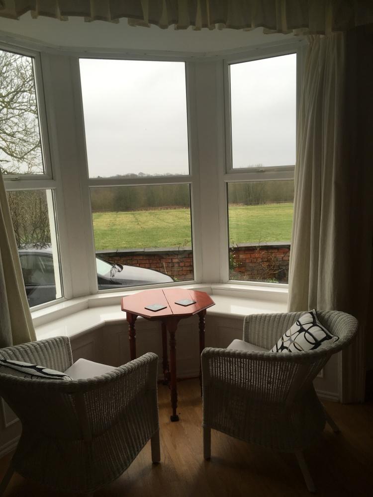 Things Helen Loves, seating in bay window with rural views