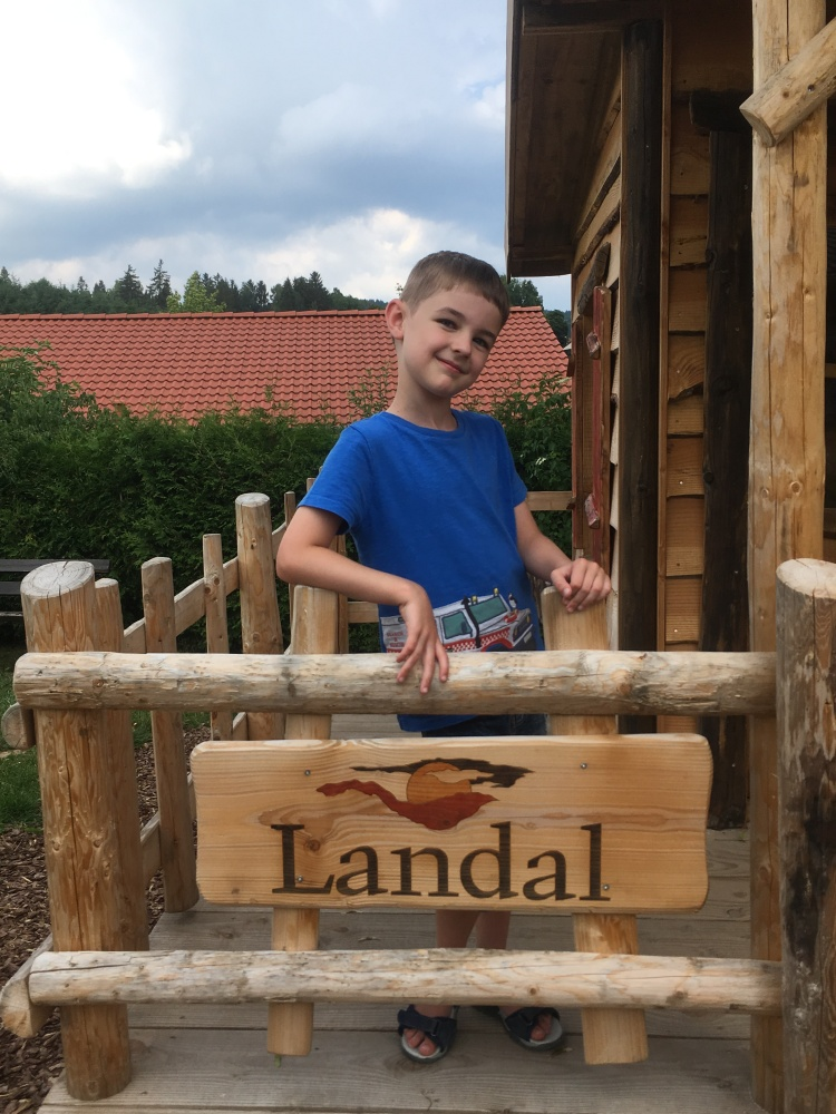 Things Helen Loves, image of boy by fence with Landal logo.