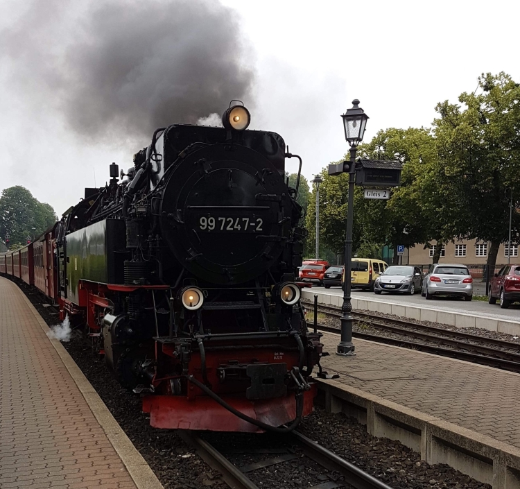 Things Helen Loves, image of black steam train pulling up to platform