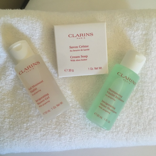 Things Helen Loves, image of Clarins products laid on white towel