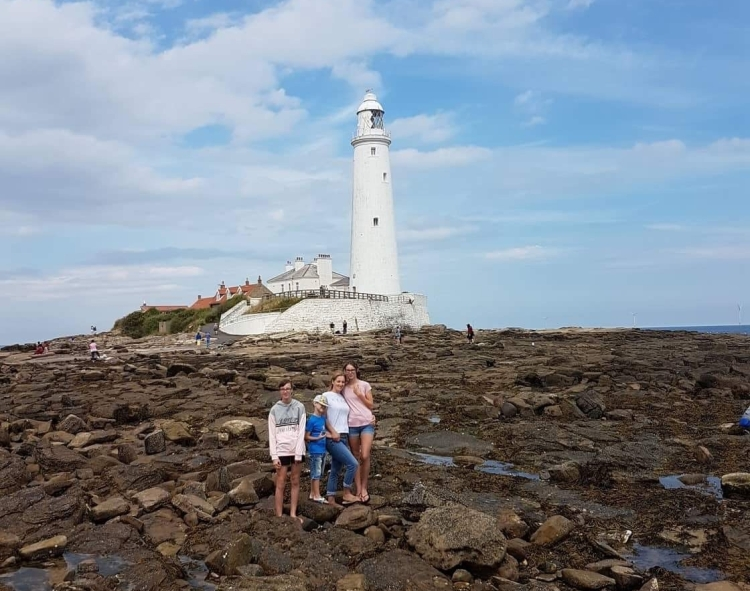 Things Helen Loves, image of family on rocks in front of lighthouse