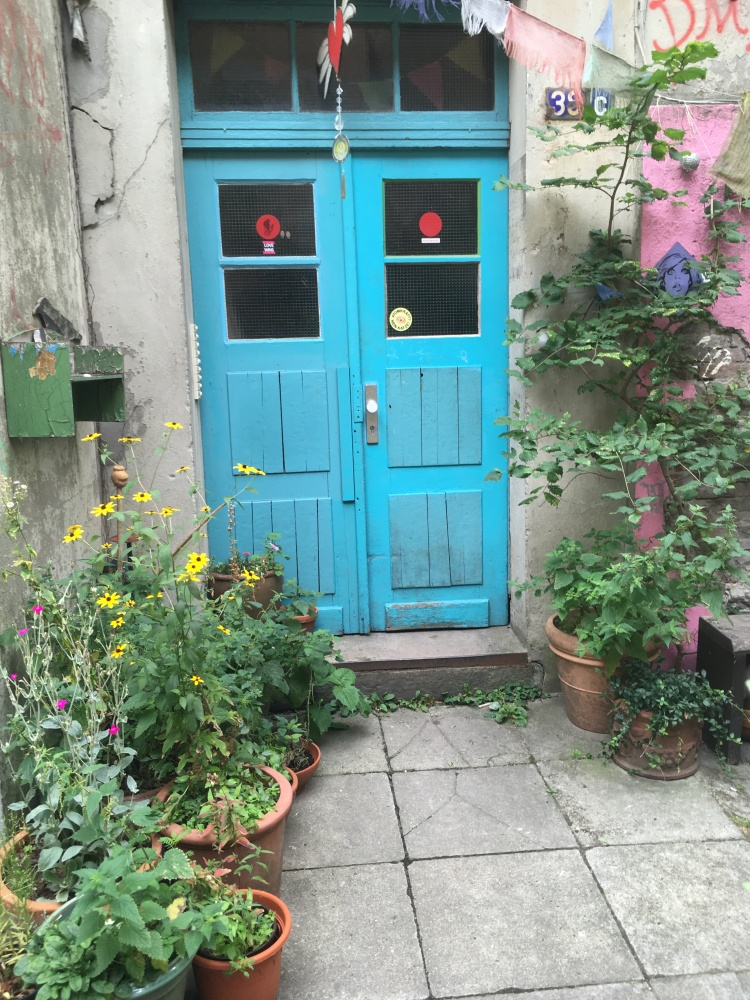Things Helen Loves, blue door surrounded by colorful plants