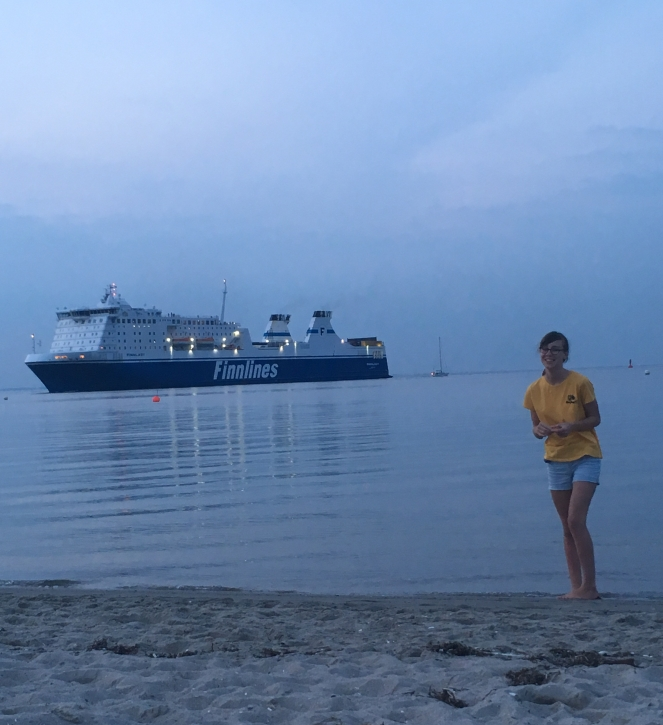 Things Helen Loves, image of girl on beach with sea and large ship in background