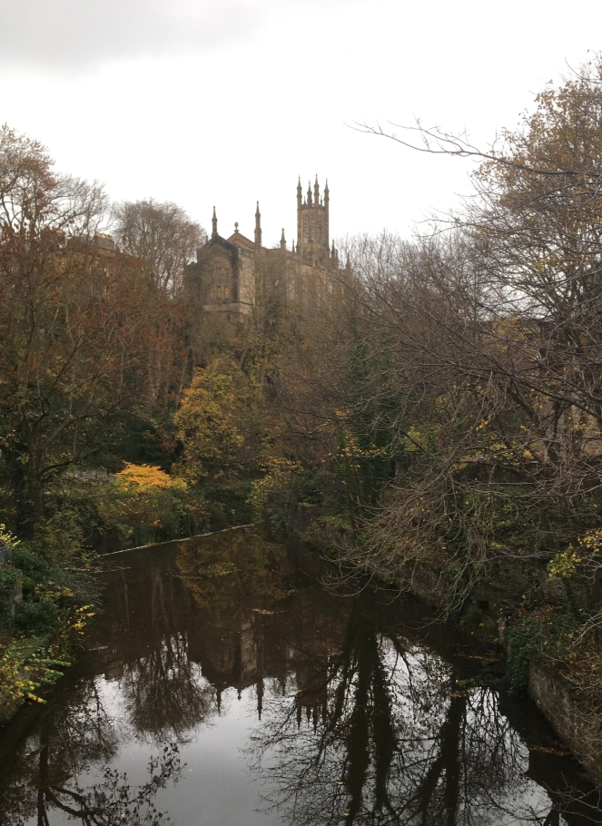 Things Helen Loves, Image od church and stream with church and trees reflected in water.