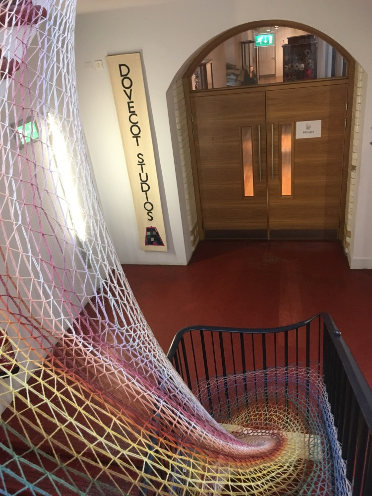 Things Helen Loves, image of colourful woven artwork round a stairwell.