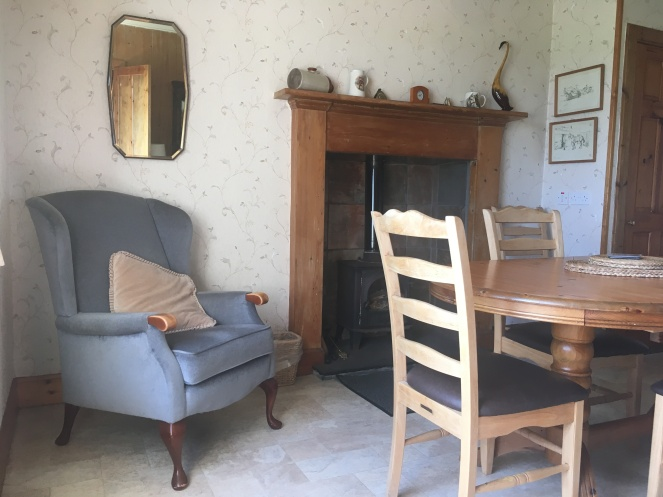 Things Helen Loves, image of farmhouse interior with log burner and traditional furnishings