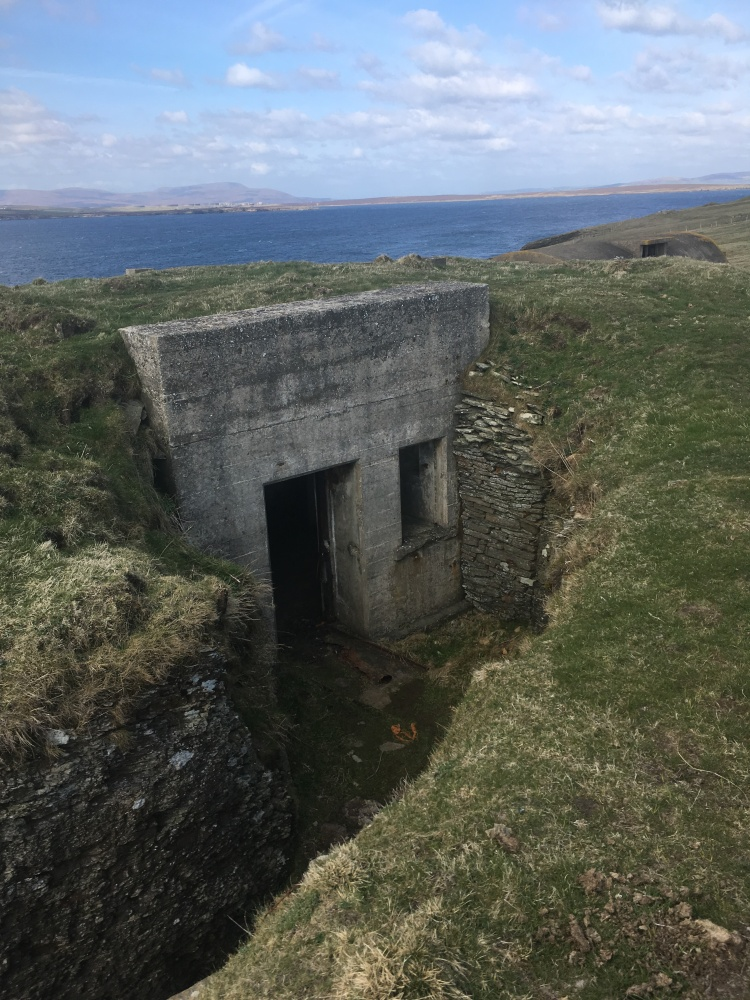 Things Helen Loves, concrete bunker set in grassy hill with sea in background