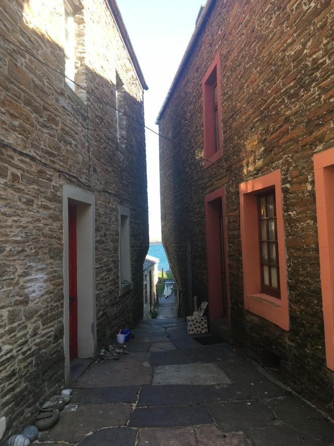 Things Helen Loves, narrow street wth glimpse of sea