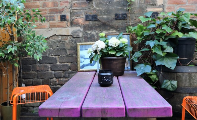 Things Helen Loves, image of flowers and seating in courtyard garden.