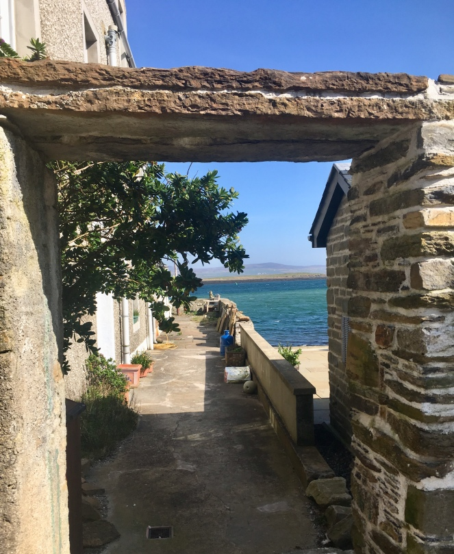 Things Helen Loves, image of stone archway and sea views