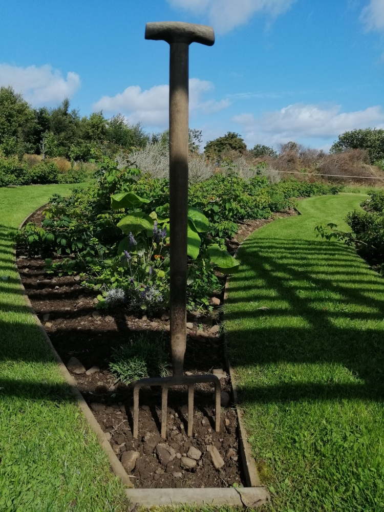 Things Helen Loves, vintage garden tools used as decoration in flower beds