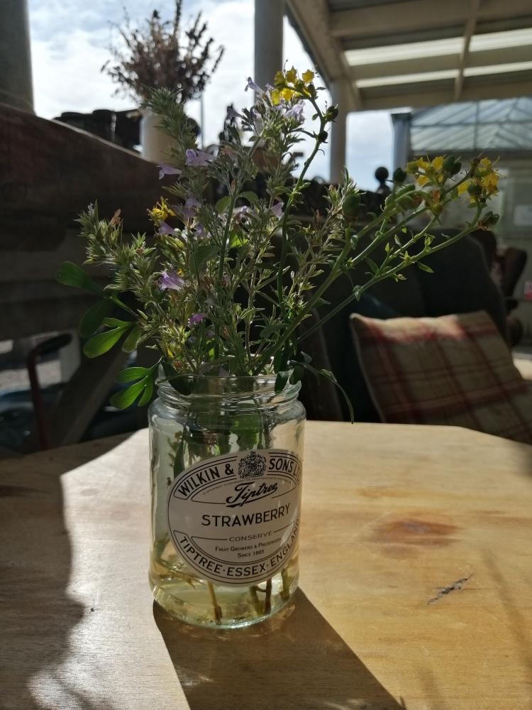 Things Helen Loves, jam jar with rustic flower display in it.
