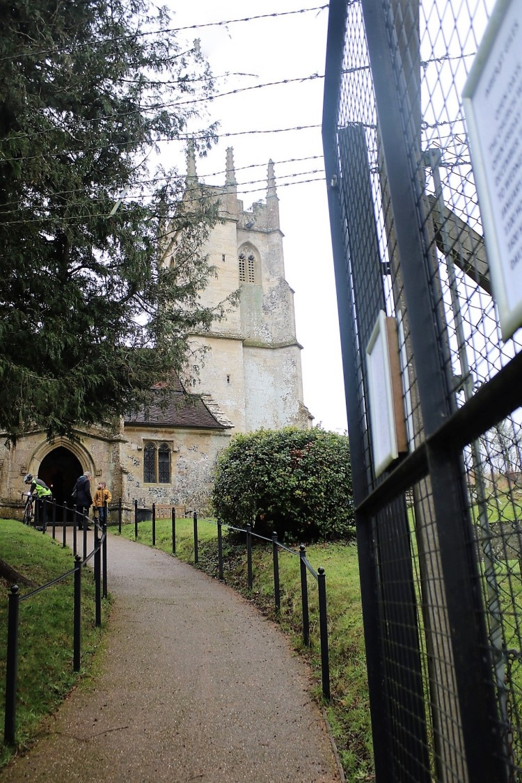 Things Helen Loves, image of chuch behind wire fence and barbed wire gate