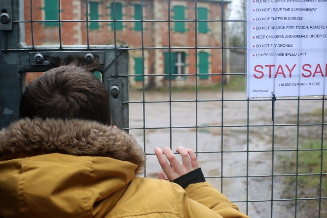 Things Helen Loves, image of boy looking at manor house through metal security gate
