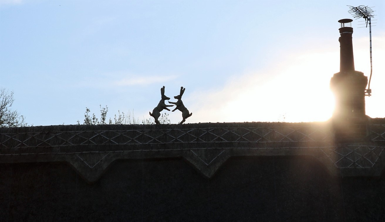 Things Helen Loves, image of straw animals on cottage roof.