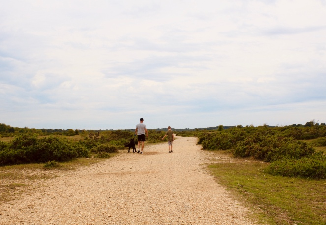 Things Helen Loves, image of Boy,man and dog walking across open land at Greenham Common