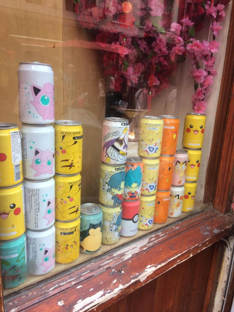 Things Helen Loves, image of colourful window display of pokemon themed drinks cans